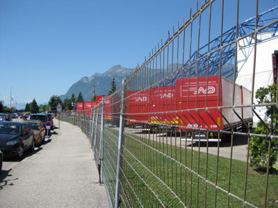Broom wagon trucks poised to sweep, the day before the race